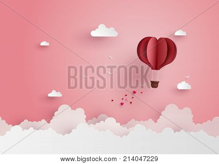 illustration of love and valentine dayOrigami made hot air balloon flying on the sky with heart float on the sky.paper art style.