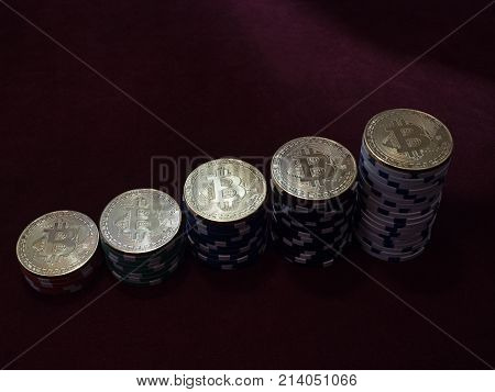 Bitcoin coins on poker chips. The ladder of financial growth. The concept of replacement bitcoin in all forms of payment.