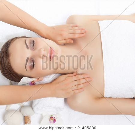 spa massage young woman on white