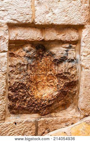 JERUSALEM, ISRAEL - NOVEMBER 2011: Handprint of Jesus in stone on the fifth station of Via Dolorosa