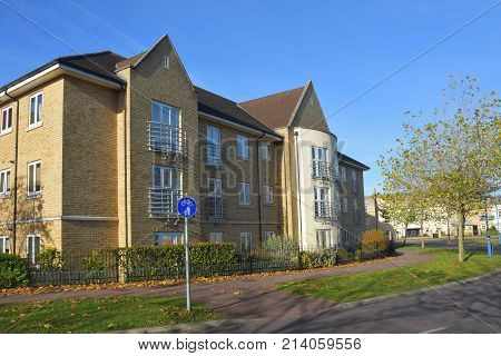 Block of Modern flats in Cambourne Cambridgeshire showing cycleway