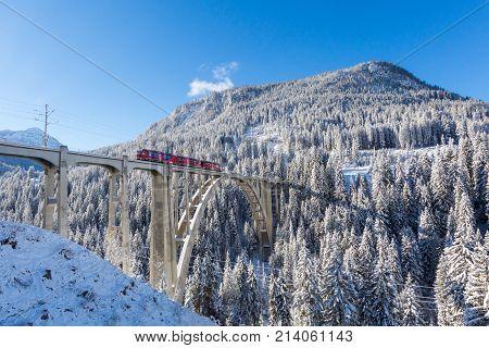 Langwies Switzerland - November 14 2017: Langwieser Viaduct in winter Langwies Switzerland.