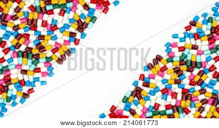 Colorful of antibiotic capsules pills on white background with beautiful pattern and copy space. Drug resistance concept. Antibiotics drug use with reasonable and global healthcare concept.