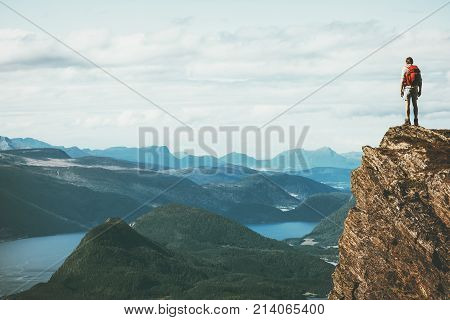 Life on the edge Traveler on cliff mountains over fjord enjoying Norway landscape Travel Lifestyle success motivation concept adventure active vacations outdoor