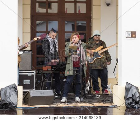 Sibiu Romania October 07 2017 : A group of musicians performs on the street in front of The State Philharmonics Sibiu - Thalia Concert Hall. Sibiu city in Romania