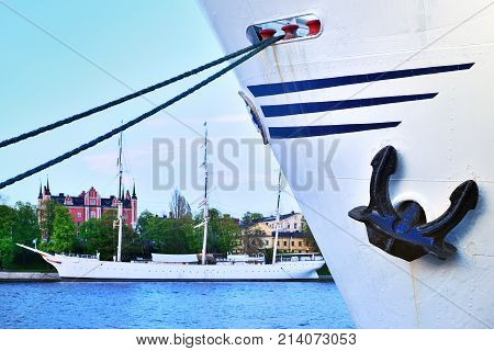 Ship With Ankor Against Water And Sailing Ship