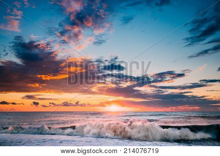 Sun Is Shining Over Horizon At Sunset Or Sunrise. Evening Sea Or Morning Ocean. Sea Ocean Waves In Colorful Sunset Sunrise Sky Lights. Natural Sky Warm Colors.