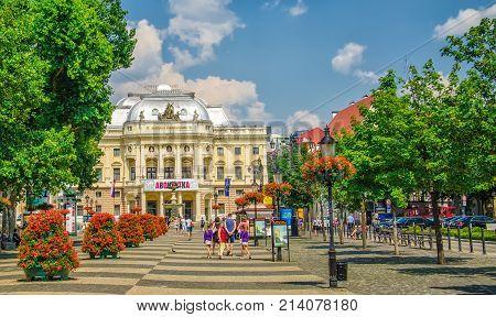 BRATISLAVA, SLOVAKIA - JULY 10, 2013: Neo-renaissance building of Slovak National Theater and Hviezdoslavovo square with pedestrians.