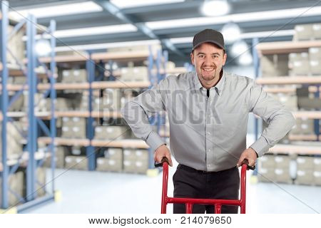 classic warehouse and smiling deliveryman