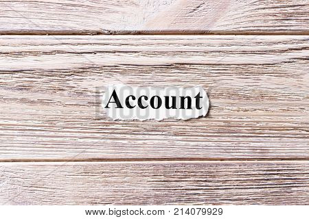 Account of the word on paper. concept. Words of Account on a wooden background.