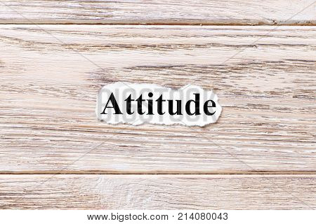 Attitude of the word on paper. concept. Words of Attitude on a wooden background.