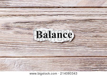 Balance of the word on paper. concept. Words of Balance on a wooden background.