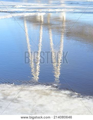 Reflection of cable stayed bridge on the outskirts of St. Petersburg at sunny winter day Russia. poster
