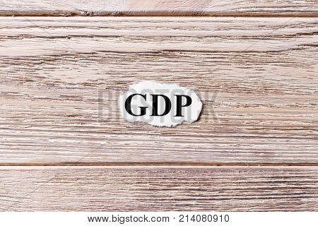 GDP of the word on paper. Gross Domestic Product concept. Words of GDP on a wooden background.