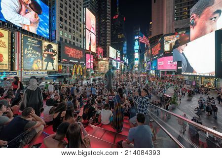Times Square at night on July 30, 2017 in Manhattan, New York. Times Square is a busy tourist intersection of neon art, commerce and is an iconic street of New York.