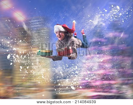 An amazing emotional portrait of a girl. Girl flying in a fantastic whirl of snow. Christmas hat gifts in hand.