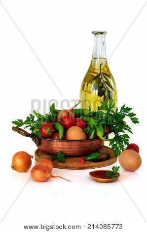 Menemen. close-up still life with mixed vegetables in frypan eggs and olive oil and tomato paste isolated on white background