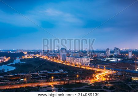 Minsk, Belarus. Picturesque Panoramic Aerial View Cityscape In Bright Blue Hour Evening And Yellow Illumination Spring Twilight.