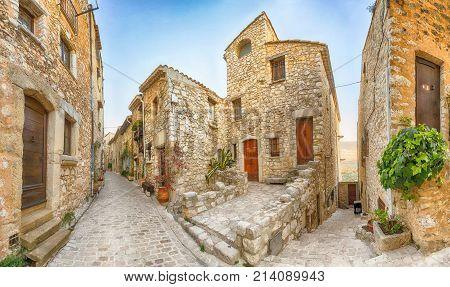 Narrow street of medieval mountain village Tourrettes-sur-Loup Alpes-Maritimes France