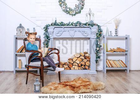 5 Years Old Little Girl Reading Book With Winter Tales From Santa Claus. Concept New Year, Merry Chr