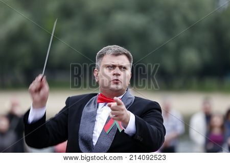 Belarus the city of Gomel June 3 2017. Independence Day in Belarus. Speech city orchestra. The conductor conducts the orchestra.Profession conductor
