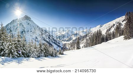 Snow mountains winter landscape on sunny day. Allgaeu Alps, Bavaria in Germany.