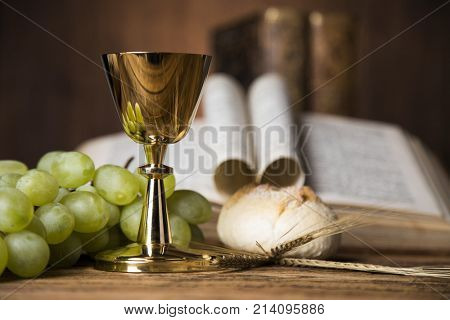 Eucharist symbol of bread and wine, chalice and host, First communion background