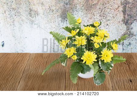 Yellow Chrysanthemums On A  Wooden Floor