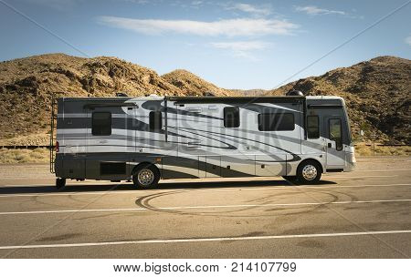 ARIZONA - OCTOBER 31 2017: Self-propelled recreational vehicle parking in the desert. RV offers living accommodation combined with a vehicle engine and is a common way to tour the US from coast to coast.