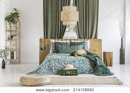 Wicker Lampshade Above Bed