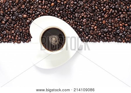 Coffee Beans On White Background In Half Frame With White Coffee Cup