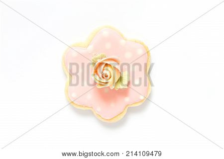 Biscuit top with sugar rose flower on white background taken in top view