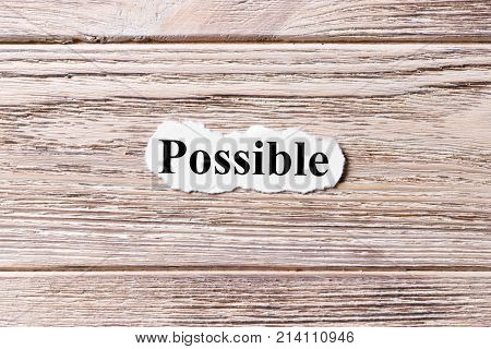 possible of the word on paper. concept. Words of possible on a wooden background.