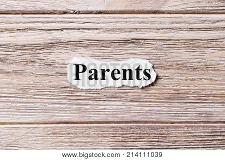 PARENT of the word on paper. concept. Words of PARENT on a wooden background.