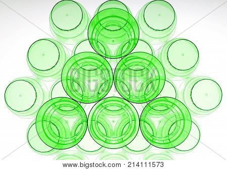 Abstract shapes of plastic cups. Triangle and hexagon rounded shape. Glasses for beverages: alcohol and non-alcohol.