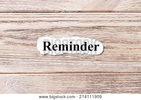 reminder of the word on paper. concept. Words of reminder on a wooden background.