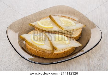 Sandwiches With Smoked Halibut, Lemon In Plate On Wooden Table