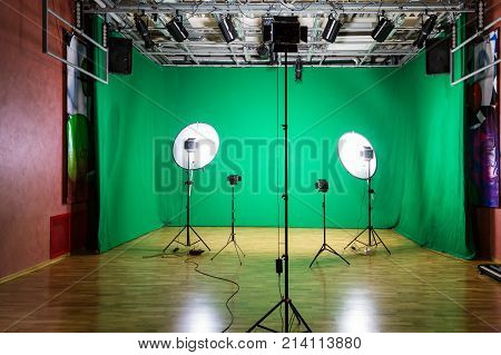 Studio for movies. Green screen. The chroma key. Lighting equipment in the pavilion. Show business