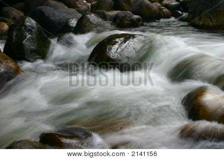 Long exposure of Popo Agie river cascading over rocks Sinks and Rise State Park Wyoming poster
