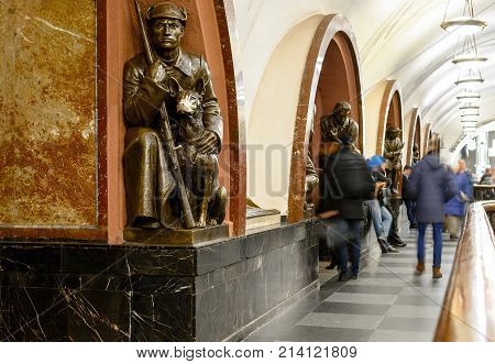 MOSCOW, RUSSIA - NOVEMBER 16, 2017: Subway station Revolution Square. Bronze Sculpture of soviet soldier with dog. According to the tradition of rubbing the nose of this dog you will have good luck