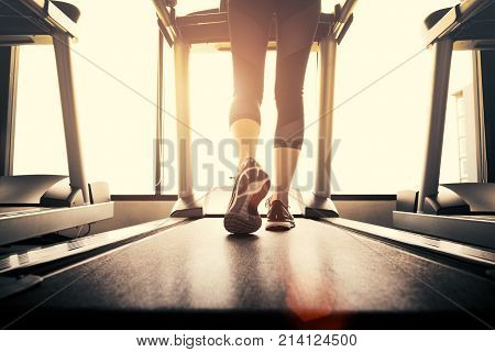 Lower Body At Legs Part Of Fitness Girl Running On Running Machine Or Treadmill In Fitness Gym With