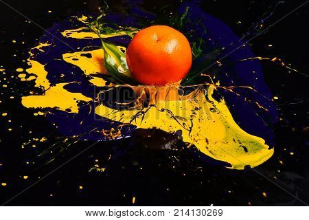 Orange Or Tangerine Covered With Paints. Nutrition And Food Art