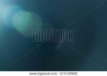 Real Lens flare light effect. Sparkle ray leak on black background. Optical effect of spotlight. Flash leak beam.