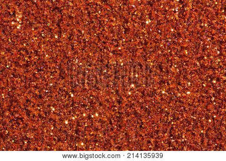 Saturated brick-colour background with glitter. High resolution photo.