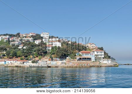 View of Burgazada island from the sea with summer houses. The island is the third largest one of four islands named Princes' Islands in the Sea of Marmara near Istanbul Turkey