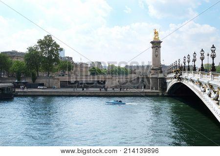 PARIS, FRANCE - APRIL 29, 2017: View of Seine and famous Alexandre III Bridge