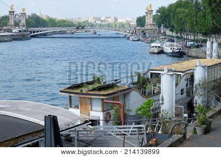 PARIS, FRANCE - APRIL 29, 2017: View of Seine embankment and famous Alexandre III bridge