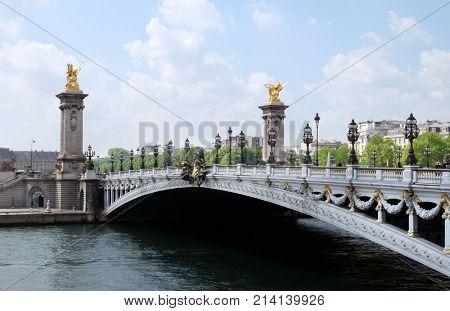 PARIS, FRANCE - APRIL 29, 2017: Famous Alexandre III Bridge