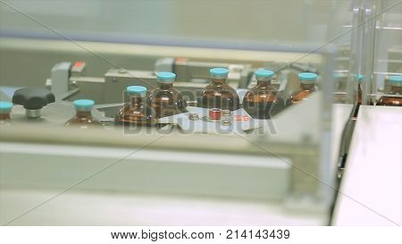 Pharmaceutical industry. Production line machine conveyor at factory with bottles. pharmaceutical production of liquid pharmaceuticals HD