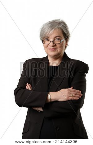 Mature businesswoman looking at camera, smiling, isolated on white background.
